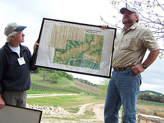 Ron Taskey and Mitch Wyss discuss exhibit poster.